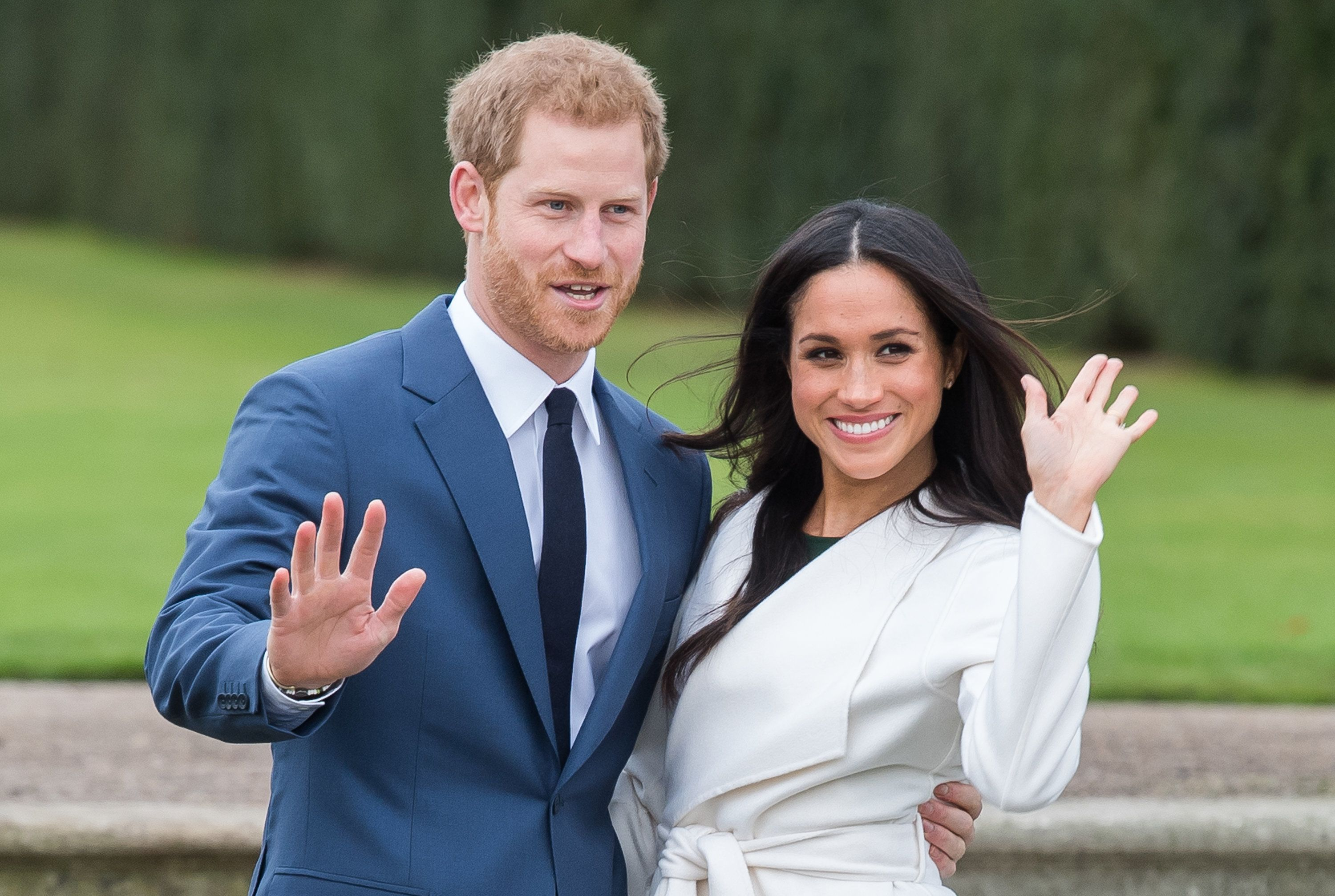LONDON, ENGLAND - NOVEMBER 27:  Prince Harry and Meghan Markle during an official photocall to announce the engagement of Prince Harry and actress Meghan Markle at The Sunken Gardens at Kensington Palace on November 27, 2017 in London, England.  Prince Harry and Meghan Markle have been a couple officially since November 2016 and are due to marry in Spring 2018.  (Photo by Samir Hussein/Samir Hussein/WireImage)