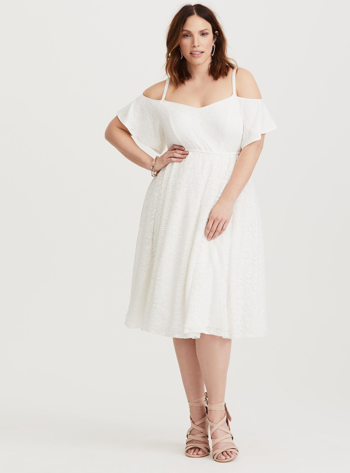 """Get it <a href=""""https://www.torrid.com/product/special-occasion-ivory-lace-skater-dress/11349703.html?cgid=dresses-specialocc"""