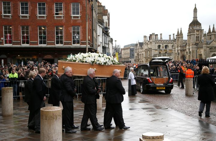 Pallbearers carry the coffin out of Great St Marys Church at the end of the funeral of theoretical physicist Stephen Hawking,