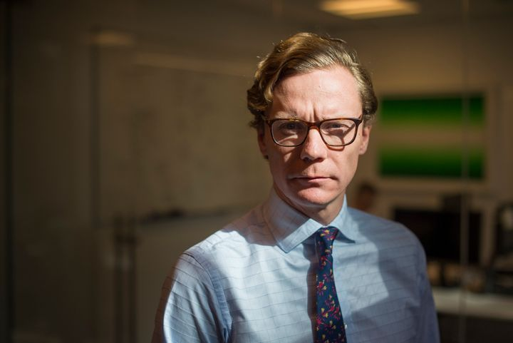 Alexander Nix, who was suspended as Cambridge Analytica's CEO in March, is seen at the company's New York City office in
