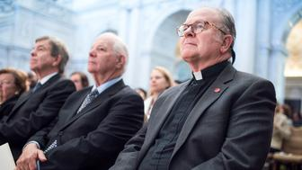UNITED STATES - SEPTEMBER 14: House Chaplain Patrick J. Conroy, Sens. Ben Cardin, D-Md., center, and Roy Blunt, R-Mo., attend a swearing-in ceremony for the new Librarian of Congress Carla Hayden, in the Great Hall of the Library of Congress Thomas Jefferson Building, September 14, 2016. (Photo By Tom Williams/CQ Roll Call)