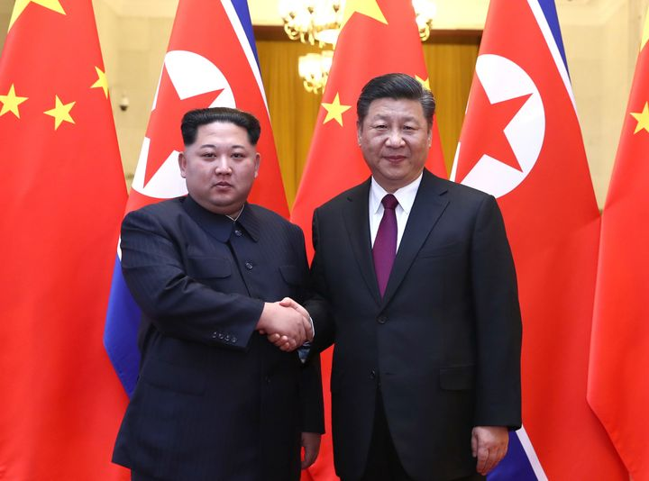 North Korean leader Kim Jong Un meets with Chinese President Xi Jinping in Beijing on March 28, 2018.