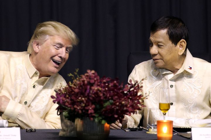 U.S. President Donald Trump speaks with Philippines President Rodrigo Duterte in Manila, Philippines, November 12, 2017.