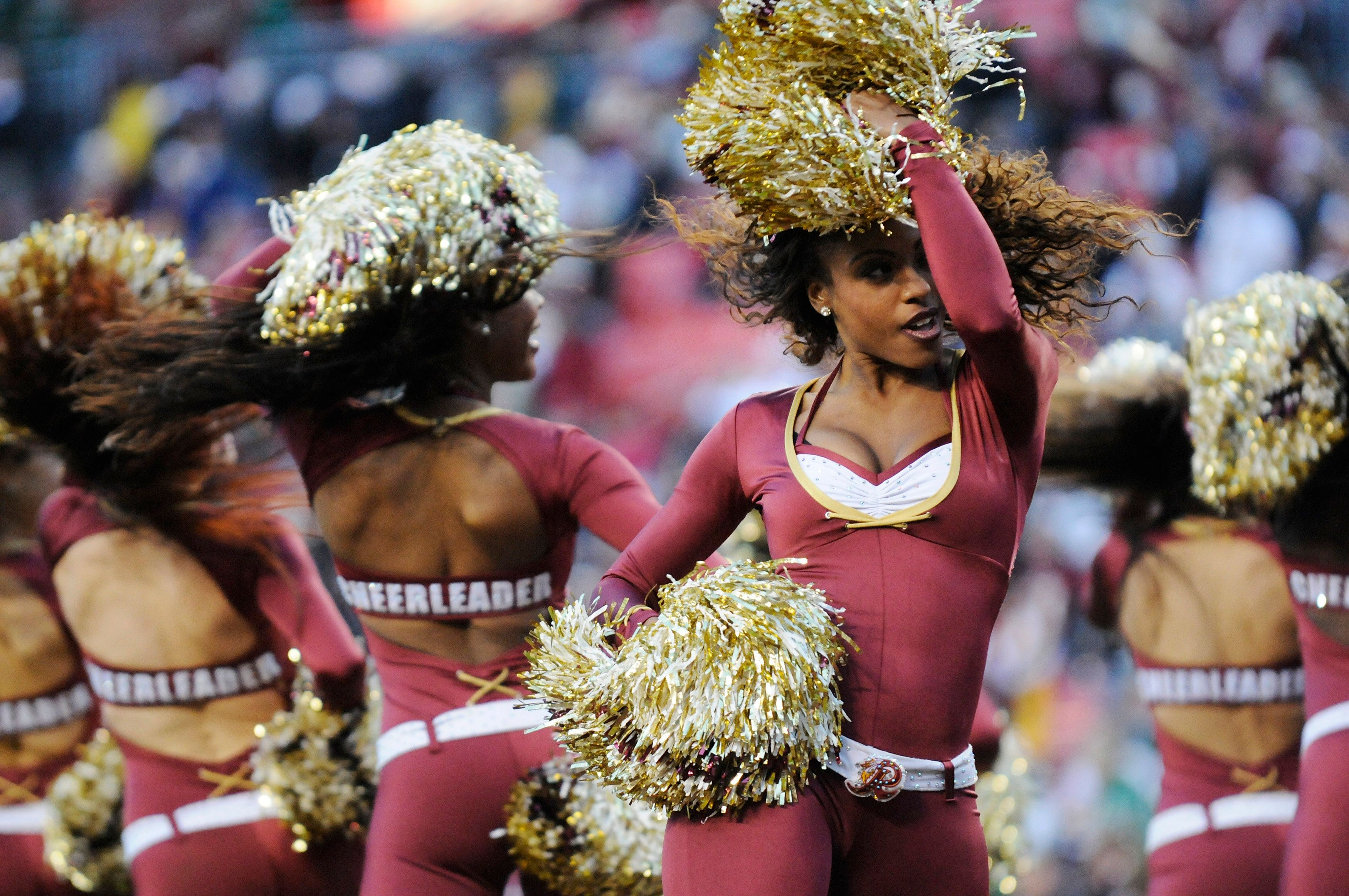 Washington Redskins cheerleaders perform during a break in the action during the second half of the NFL football game between the New York Jets and the Washington Redskins in Landover, Maryland, December 4, 2011. REUTERS/Jonathan Ernst   (UNITED STATES - Tags: SPORT FOOTBALL)