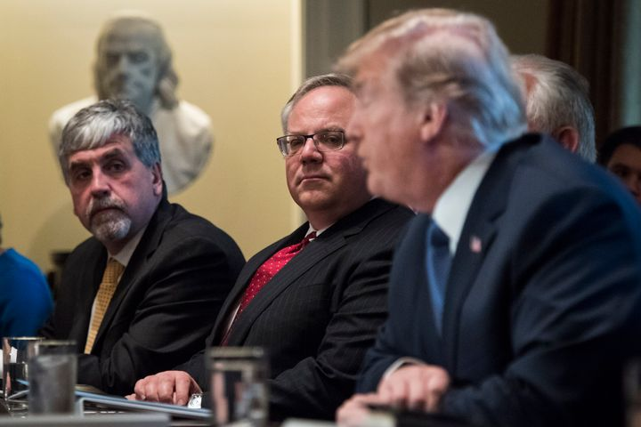 Deputy Interior Secretary David Bernhardt, center, listens as President Donald Trump speaks at a White House Cabinet meeting