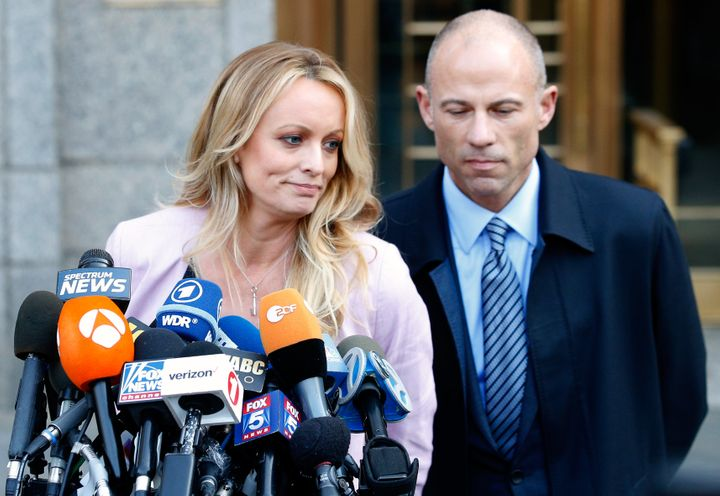 Adult film actress Stephanie Clifford, also known as Stormy Daniels, with her lawyer Michael Avenattiin New York City o