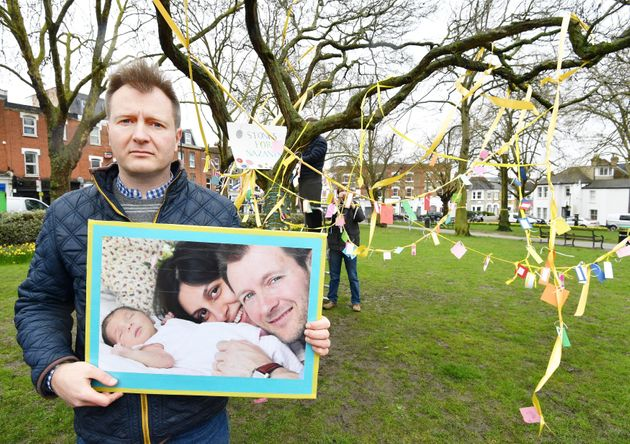 Richard Ratcliffe holds a photograph of himself with wife Nazanin and their daughter Gabriella. He said...