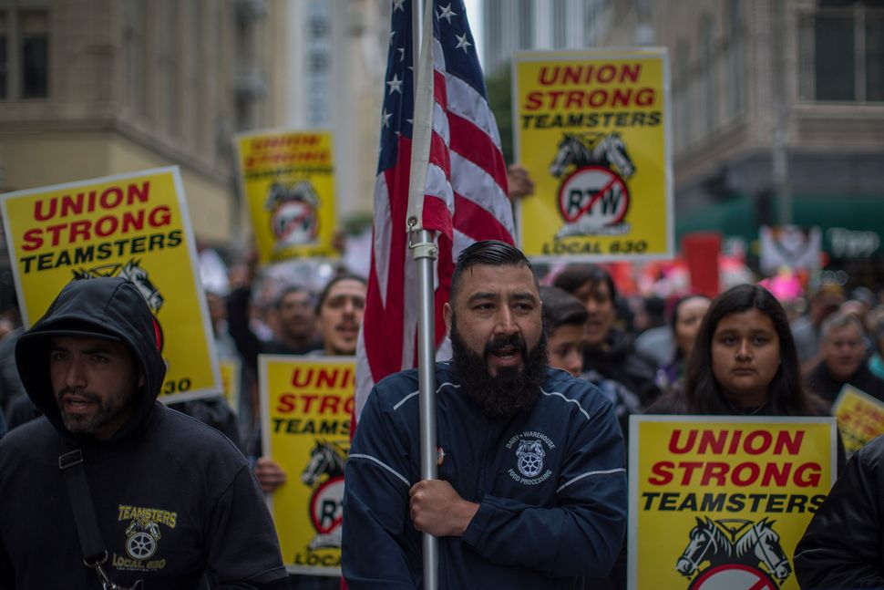 Teamsters march on May 1, 2018 in Los Angeles. Numerous May Day, or International Workers Day, marches took place in cities a