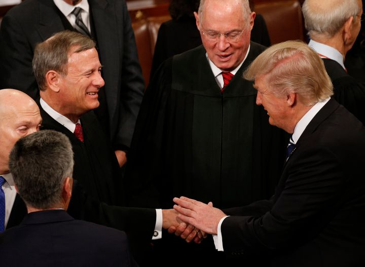 President Donald Trump greets members of the Supreme Court after he addressed a joint session of Congress on Feb. 28, 2017.
