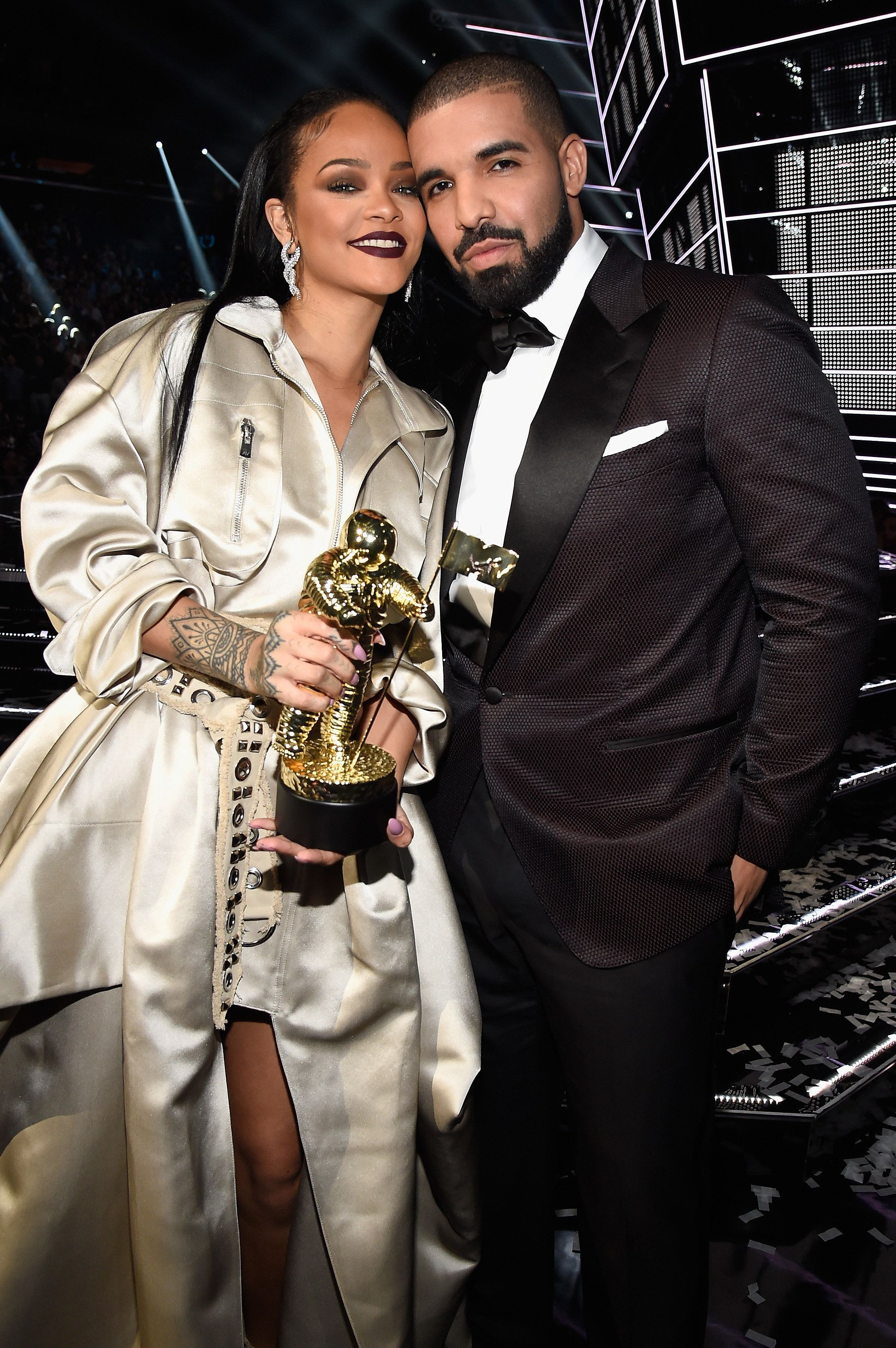 Rihanna and rapper Drake pose onstage during the 2016 MTV Video Music Awards