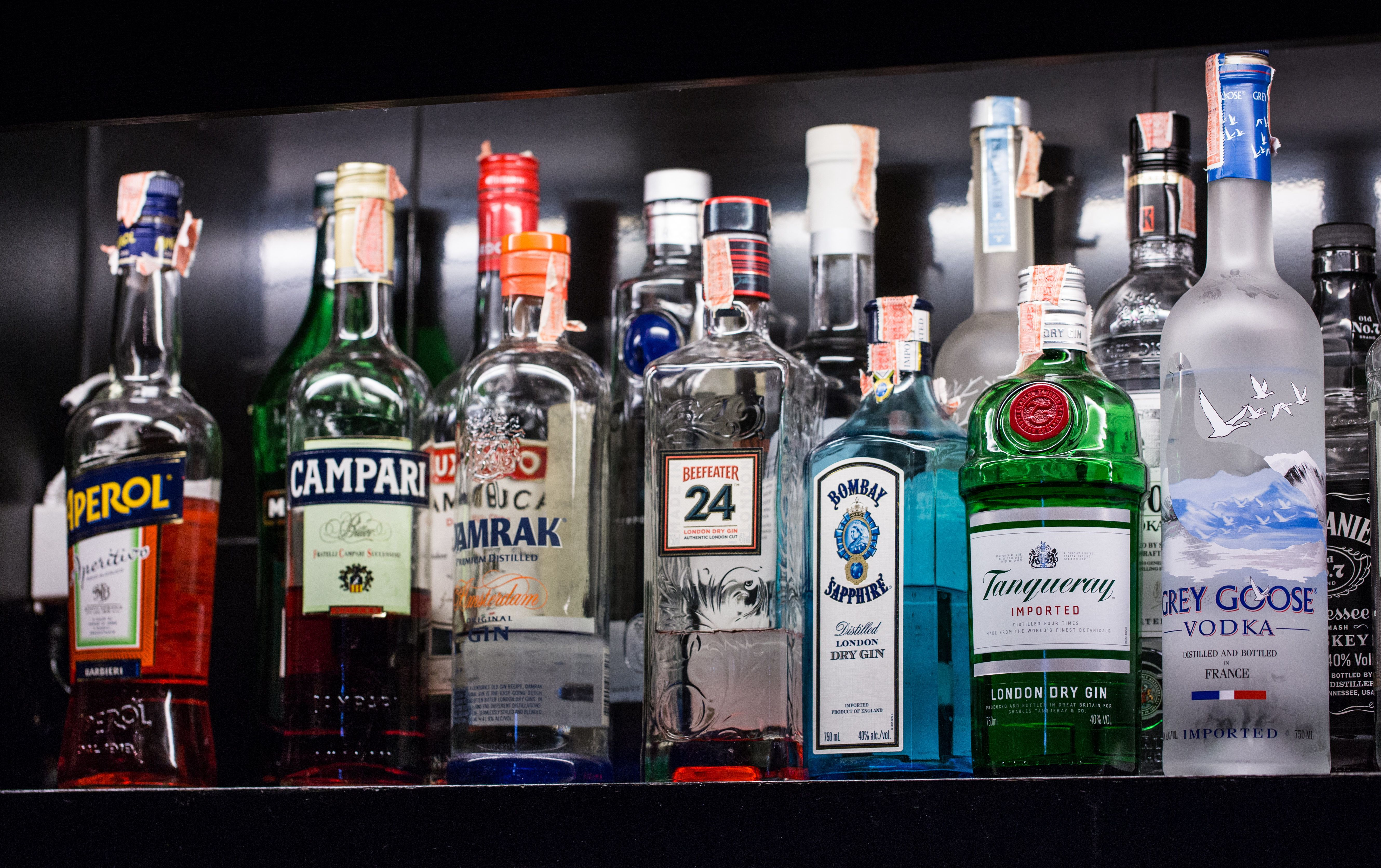 BANGKOK, THAILAND - October 23, 2017 - A variety of alcoholic beverages, Bernd, are placed on shelves in the bar for cocktails.