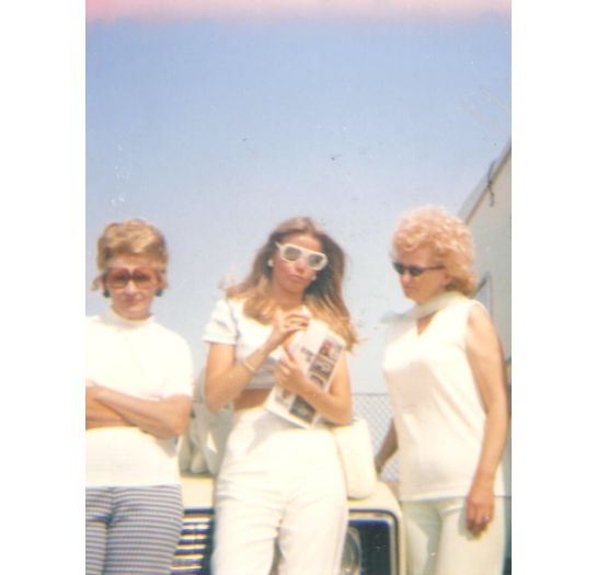 """""""This was taken around 1976 at the Ontario Raceway in California. I love it because it includes my mom (to the right) and my"""