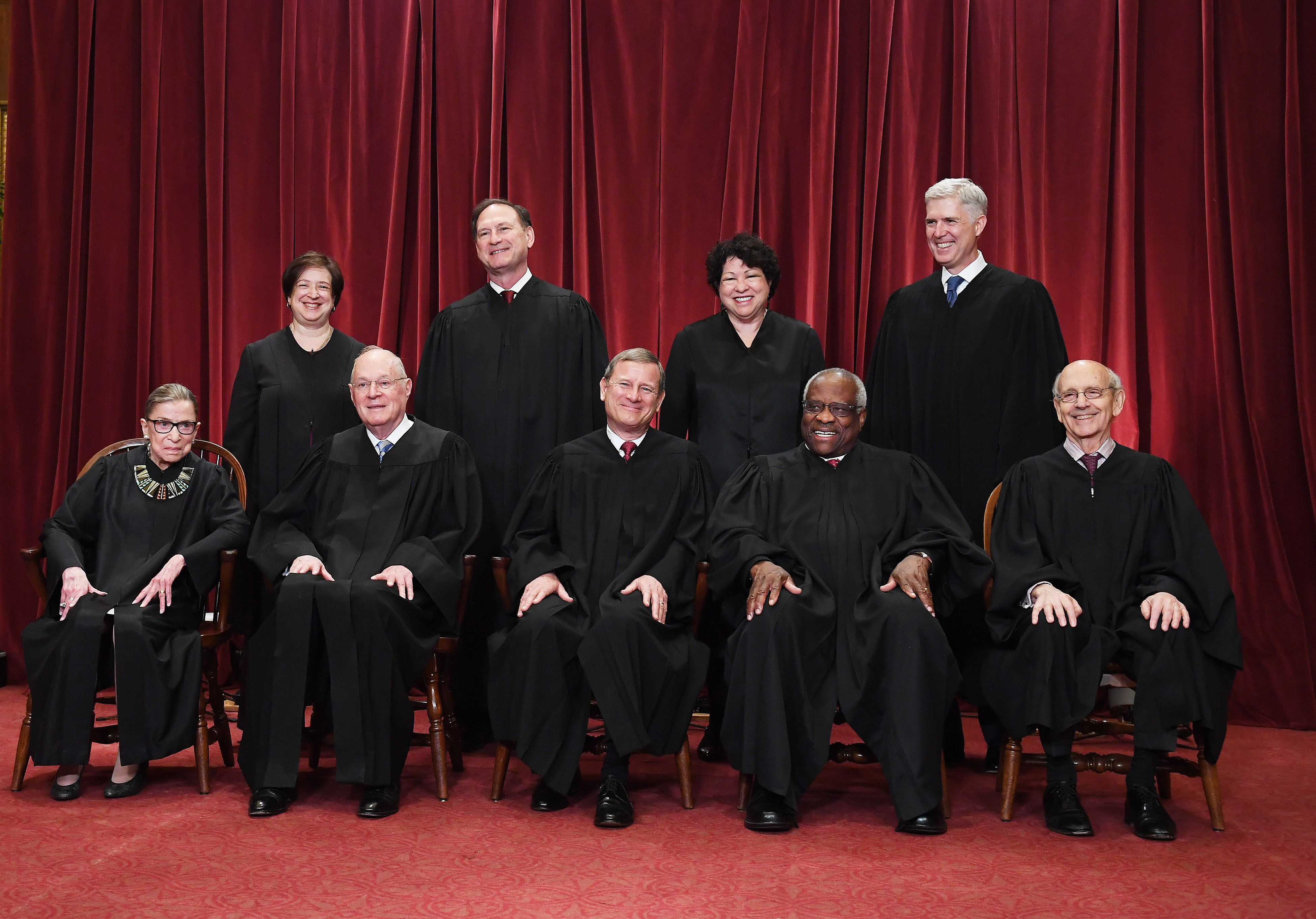 WASHINGTON, DC - JUNE 01: Seated from left, Associate Justice Ruth Bader Ginsburg, Associate Justice Anthony M. Kennedy, Chief Justice of the United States John G. Roberts, Associate Justice Clarence Thomas, and Associate Justice Stephen Breyer. Standing from left, Associate Justice Elena Kagan, Associate Justice Samuel Alito Jr., Associate Justice Sonia Sotomayor, and Associate Justice Neil Gorsuch pose for a portrait in the east conference room of the building of the Supreme Court of the United States on Thursday June 01, 2017 in Washington, DC (Photo by Matt McClain/The Washington Post via Getty Images)