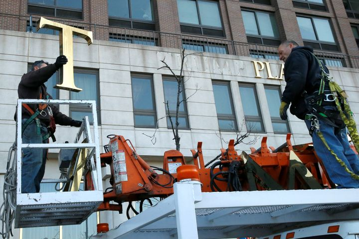 Workers remove Trump's name from a nearby Trump Place apartment building in November 2016.