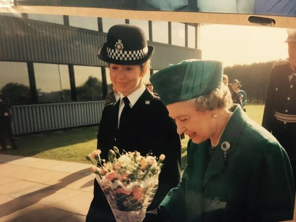 """""""My amazing mum, Ricia, escorting Queen Elizabeth! The photo was taken in Northampton in the late '90s."""" --<i>Mag"""