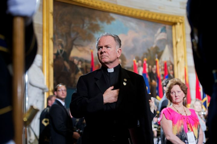 Rev. Patrick Conroy, chaplain of the House, attending the 2013 National Days of Remembrance ceremony to honor the victims of