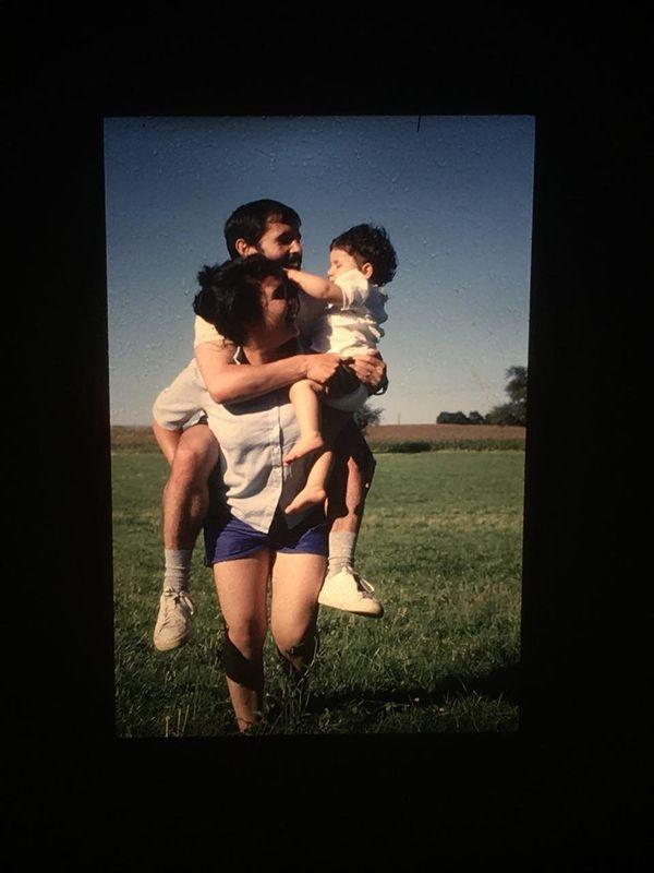 """Here's my mom, Khadija M., holding my older sister<i> and</i> my dad in 1987."" -- <i>Basma El</i>"