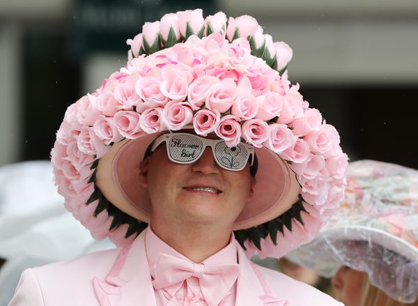 A patron wears a derby hatat the 2017 Kentucky Oaks race, which takes place at Churchill Downs the day before the Kentu