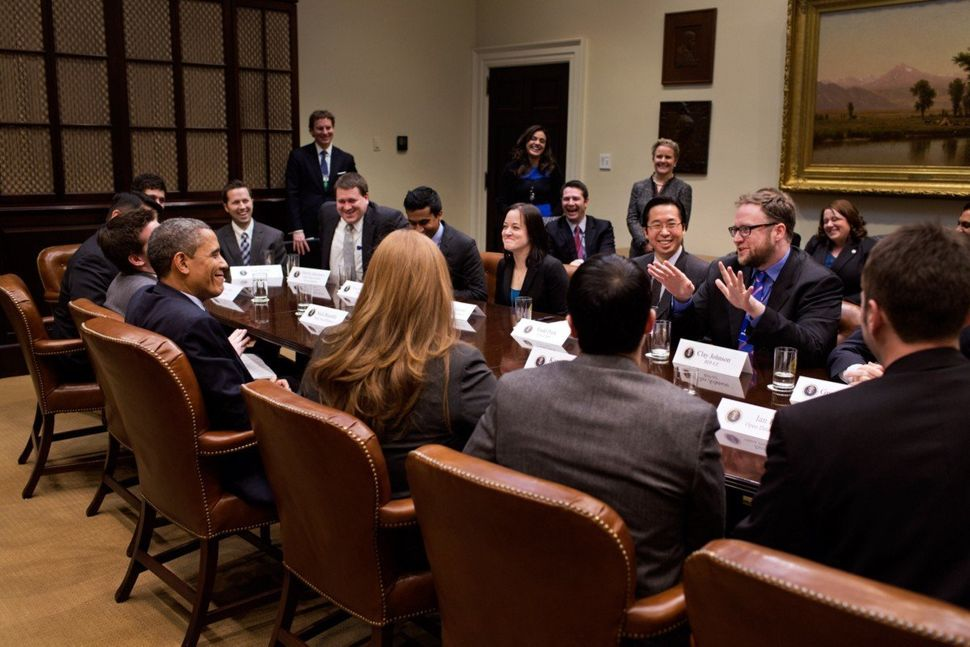 President Barack Obama meets with Clay Johnson and other Presidential Innovation Fellows in 2013. Johnson uses this photo as