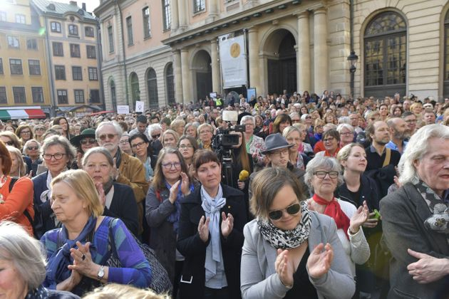 People gather at Stortorget square in Stockholm during a Swedish Academy meeting in April to support...