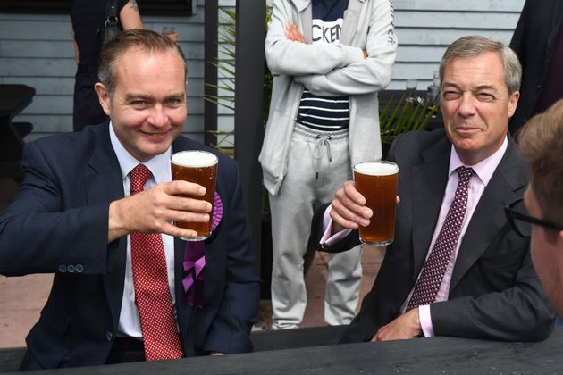Former Ukip leader Nigel Farage (right) has a pint of beer with Paul
