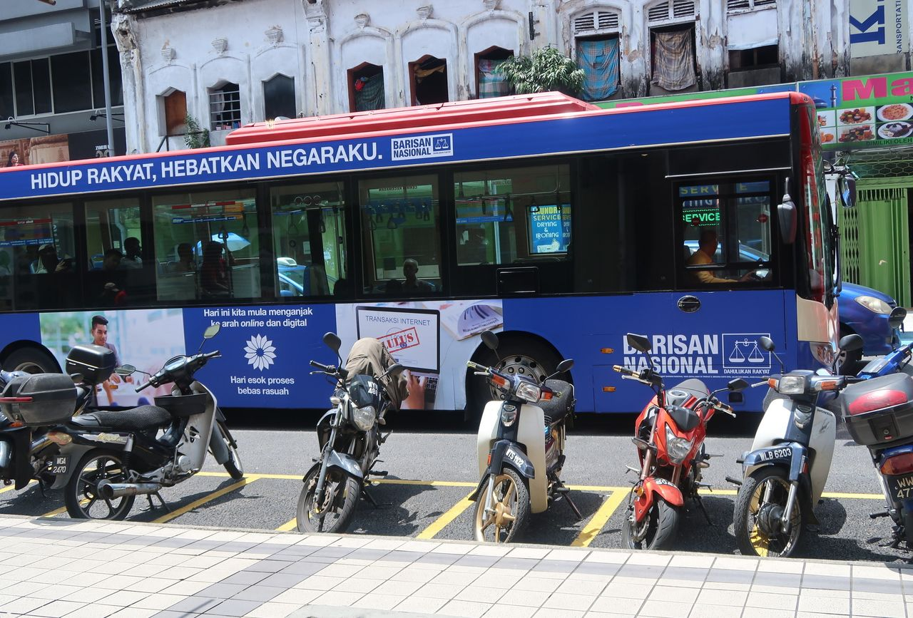 Election signs are displayed on a bus in Kuala Lumpur. The May 9 election is the first midweek contest in the country since its first election in 1959.