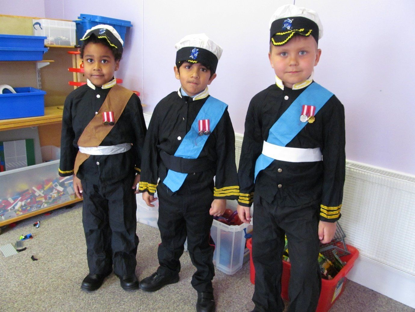 Some of the students getting into character ready for the Long Walk procession. From left to right, students dressed up as Prince William, Prince Harry and Prince Charles.