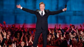 Show host Conan O'Brien opens the show at the 2014 MTV Movie Awards in Los Angeles, California  April 13, 2014.  REUTERS/Lucy Nicholson  (UNITED STATES - Tags: Entertainment) (MTV-SHOW)