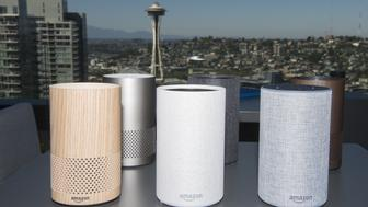 The new Amazon.com Inc. Echo devices sit on display in front of the Seattle Space Needle during the company's product reveal launch event in downtown Seattle, Washington, U.S., on Wednesday, Sept. 27, 2017. Amazon unveiled a smaller, cheaper version of its popular Alexa-powered Echo speaker that the e-commerce giant said has better sound. Photographer: Daniel Berman/Bloomberg via Getty Images