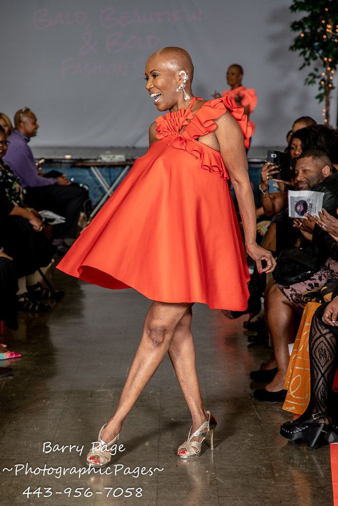 "A model walks in Alyscia Cunningham's ""I Am More Than My Hair"" fashion show."