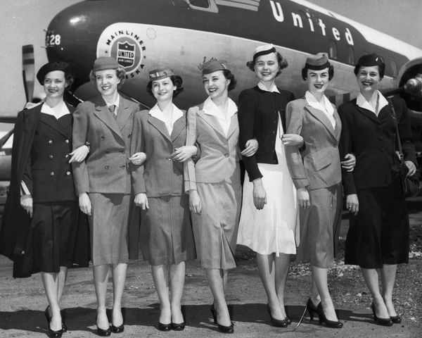 "Uniforms worn in the 25 years since ""sky girls"" first went aloft, modeled by United Airlines stewardesses. From l"