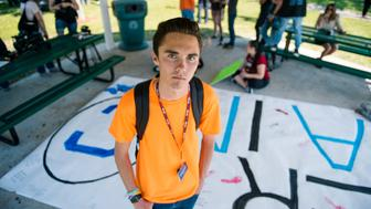 PARKLAND, FLORIDA, UNITED STATES - 2018/04/20: David Hogg, one of the leaders behind the Never Again movement, and March for Our Lives, walks out of Marjory Stoneman Douglas in honor of the 19th anniversary of Columbine, and to continue his fight for gun reform. (Photo by Emilee McGovern/SOPA Images/LightRocket via Getty Images)