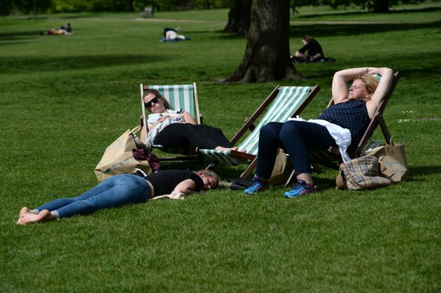 People enjoy the sun in London's Hyde