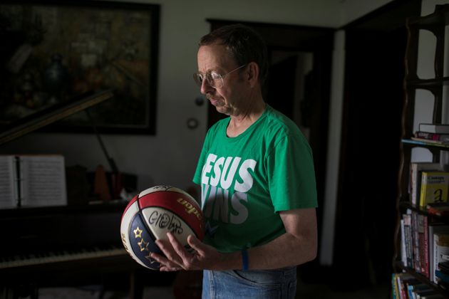 Fowle holds a basketball he brought to North Korea at this home in