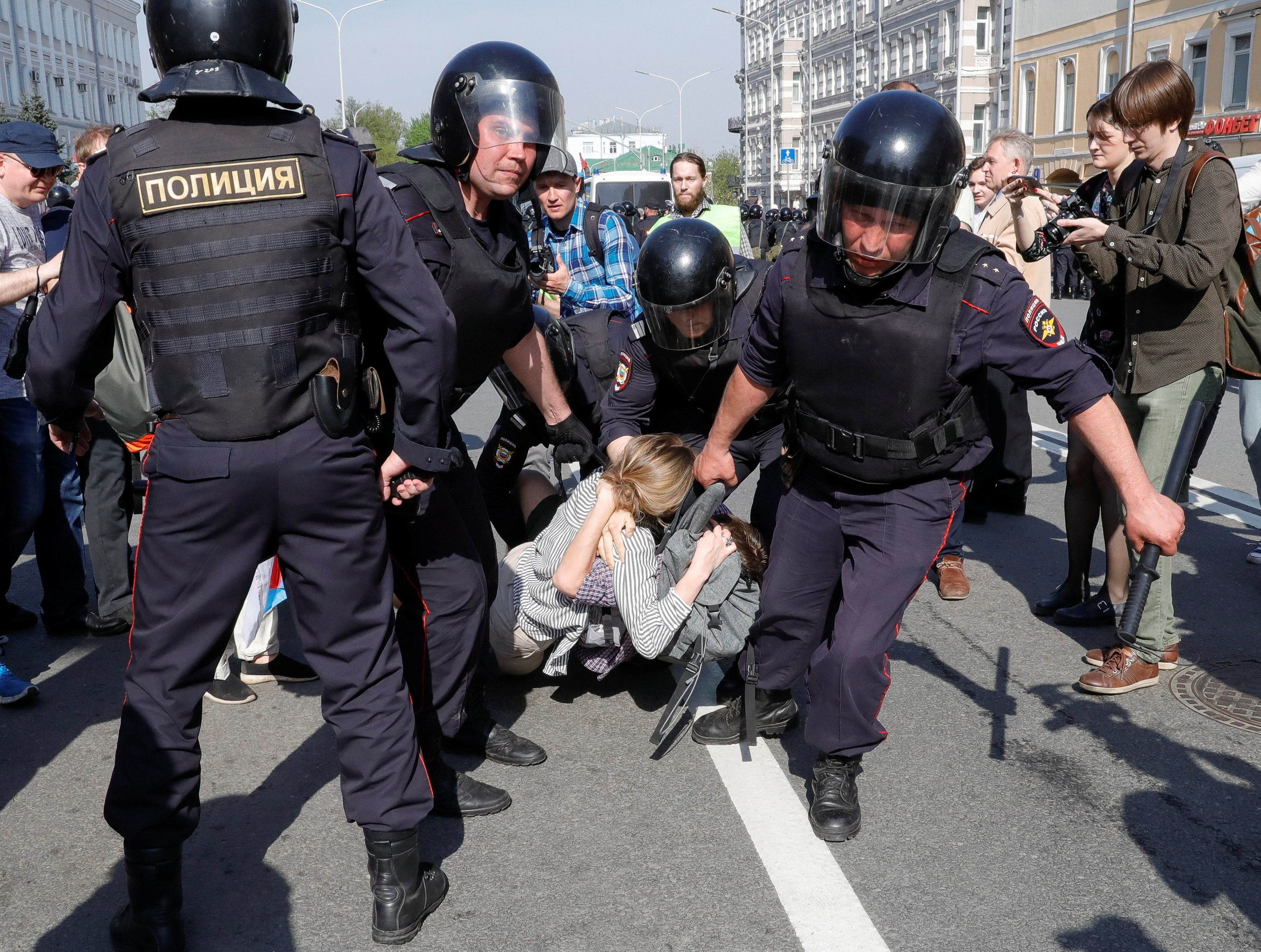 Policemen detain opposition supporters during a protest ahead of President Vladimir Putin's inauguration...