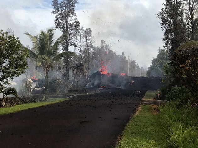 Lava pours across the road at Leilani and Kaupili Streets after the eruption of Hawaii's Kilauea volcano...
