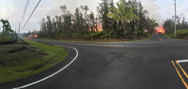 Lava advances along a street near a fissure in Leilani Estates on