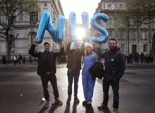 Junior doctors opposite Downing Street, London,last year, as hundreds see offers of employment...