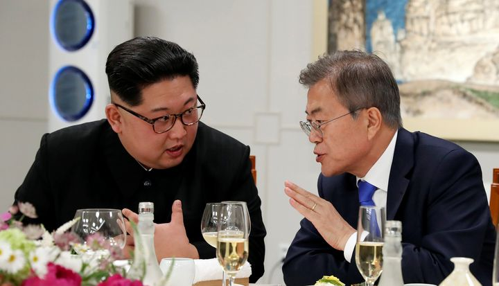 South Korean President Moon Jae-in and North Korean leader Kim Jong Un attend a banquet on the Peace House at the truce villa