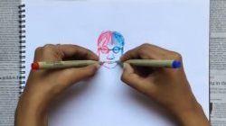 Cette artiste ambidextre dessine des deux mains en même temps
