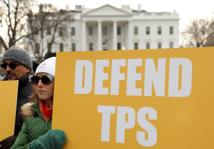 Demonstrators rally outside the White House on Jan. 8 to protest the termination of temporary protected status for