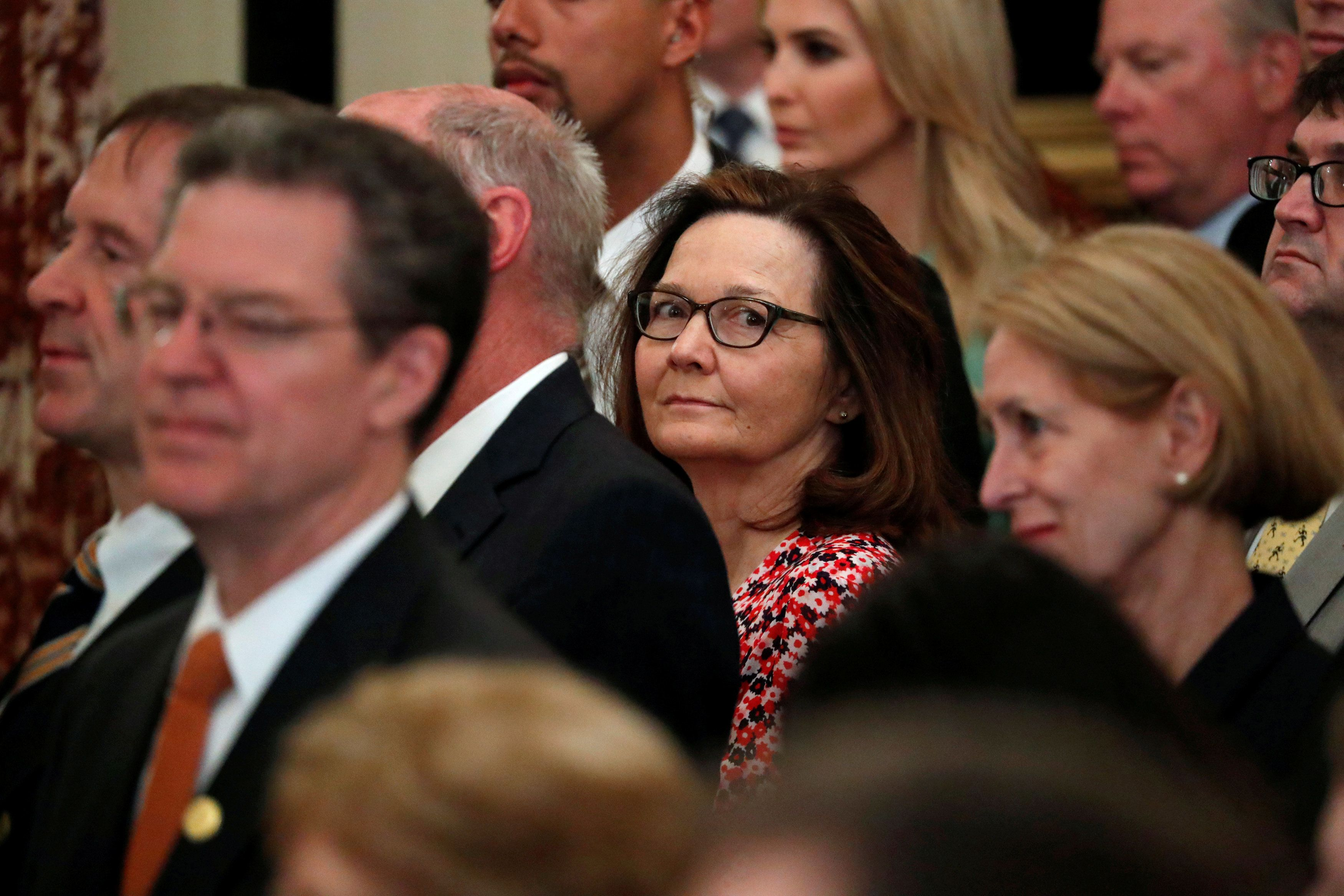 U.S. Central Intelligence Agency (CIA) director nominee Gina Haspel (C) attends Secretary of State Mike Pompeo's ceremonial swearing-in at the State Department in Washington, U.S. May 2, 2018.  REUTERS/Jonathan Ernst