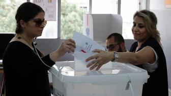 A Lebanese woman casts her vote at a polling station in Ain al-Rummaneh on the southern outskirts of Beirut on May 6, 2018,  as the country votes in its first parliamentary elections in nine years. (Photo by JOSEPH EID / AFP)        (Photo credit should read JOSEPH EID/AFP/Getty Images)