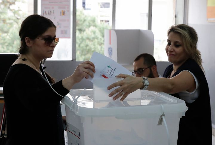 A Lebanese woman casts her vote at a polling station in Ain al-Rummaneh on the southern outskirts of Beirut.