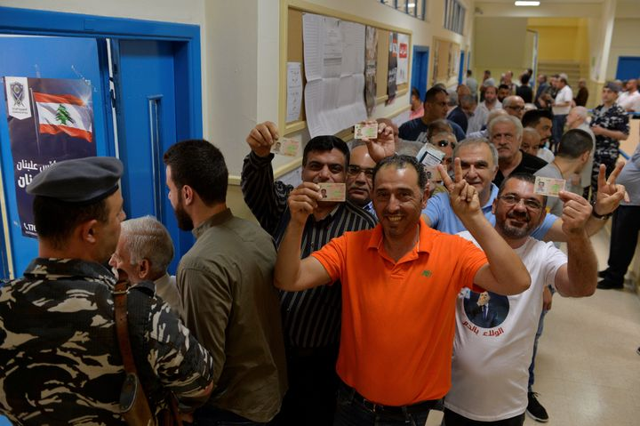 Lebanese voters queue to vote at a polling station during Lebanese general election.