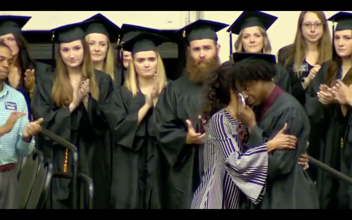 Woman accepts diploma on behalf of daughter killed in Waffle House shooting