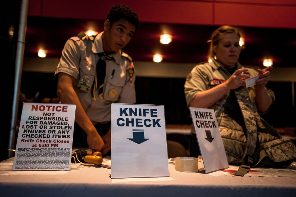 Local Boy Scouts work volunteer positions at the knife-check booth whereattendees could checkin knives, free of c