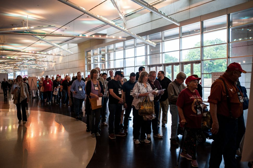 People line up hours early to get into the arena where President Donald Trump would address the crowd onFriday.