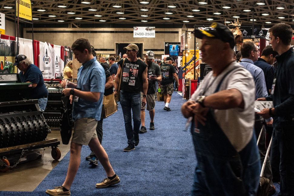 Attendees browse on the expo floor Friday.