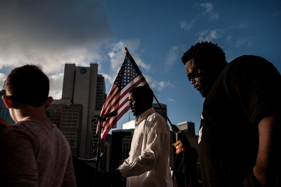 A speaker addresses the crowd at the Dallas Stands Against the NRA rally onFriday near theassociation'sannu